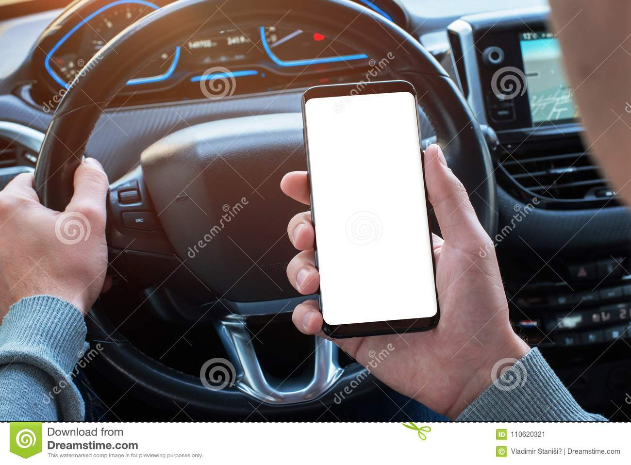 Man holding smartphone in car with isolated, white display for mockup, app, or web site design promotion