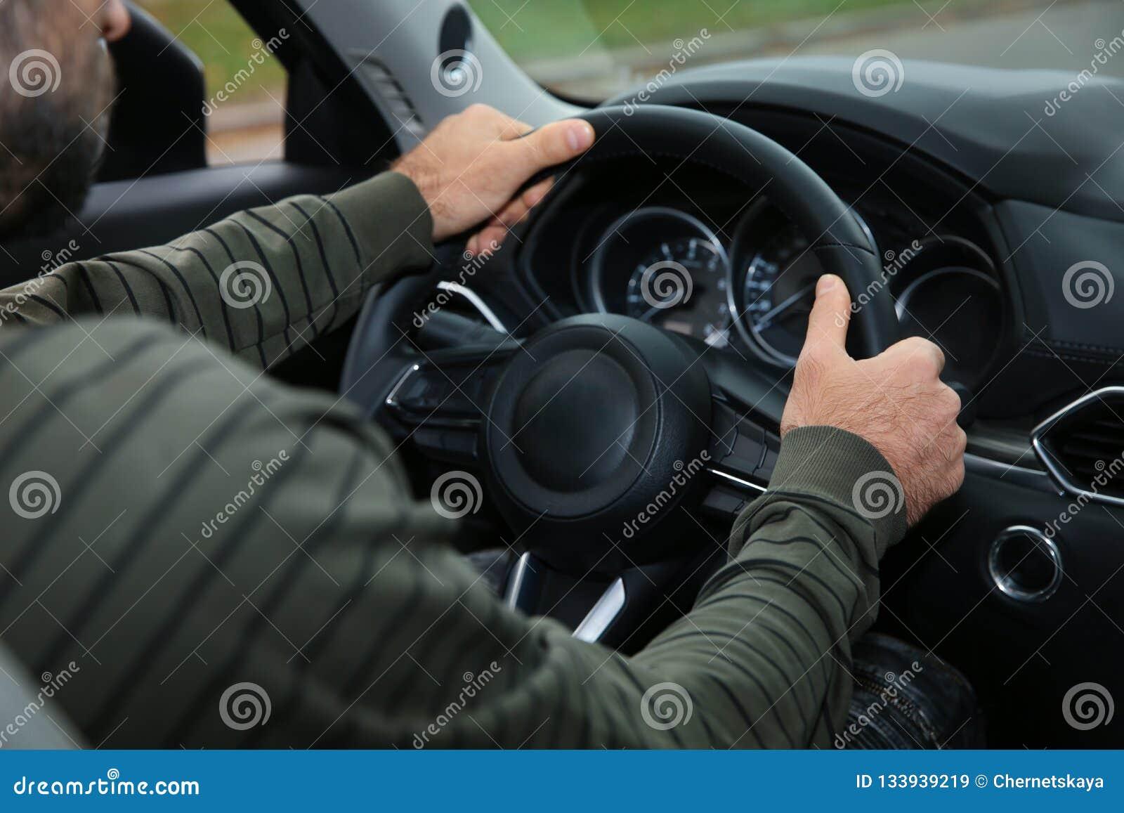 Man Holding Steering Wheel In Car, Closeup  Driving Test Stock Image