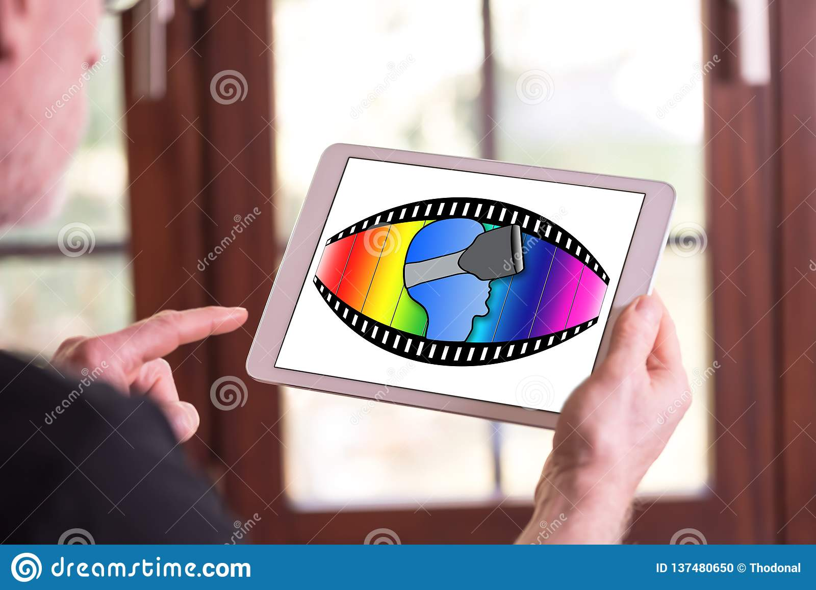 Virtual reality concept on a tablet. Man holding a tablet showing virtual reality concept stock photo