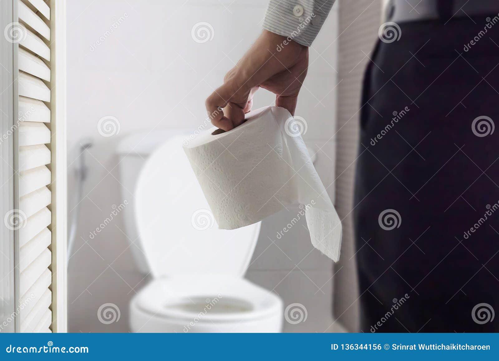 Pleasant Man Holding Tissue Paper Standing Next To Toilet Bowl Stock Creativecarmelina Interior Chair Design Creativecarmelinacom