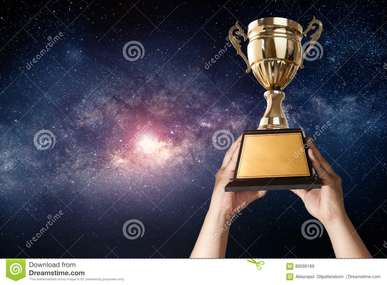 a man holding up a gold trophy cup with milky way sky background