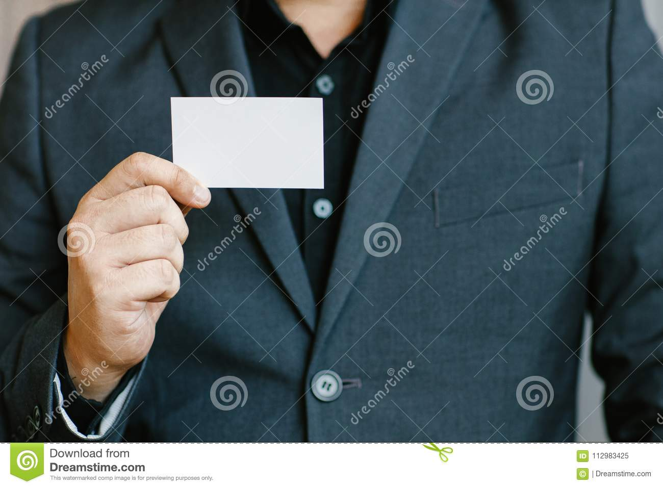 Man holding white business card stock image image of identity man holding white business cardman wearing blue shirt and showing blank white business card blurred background horizontal mockup smart asian business colourmoves