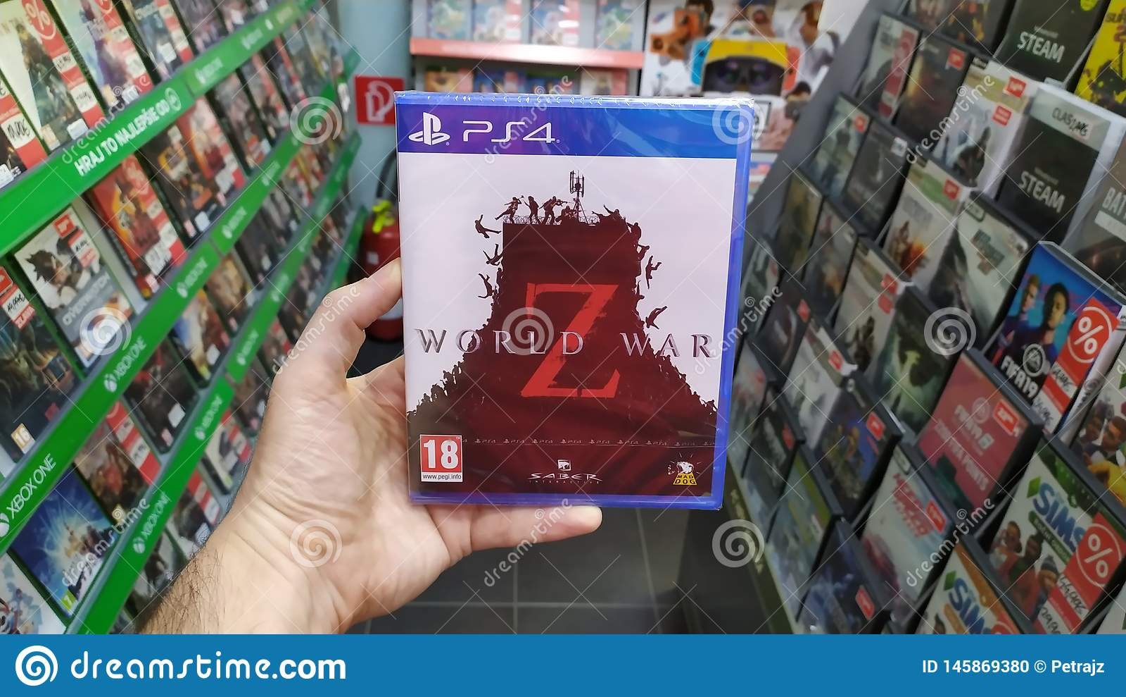 Man Holding World War Z Videogame On Sony Playstation 4