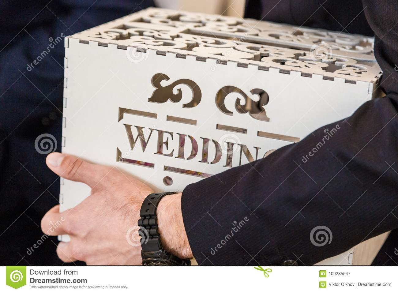 Man Holds In His Hand A Wedding Box With A Wedding Inscription For