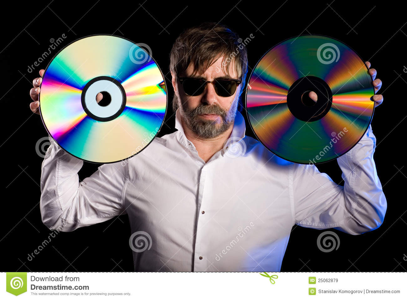 Man Holds A Retro Laser Discs Royalty Free Stock Images