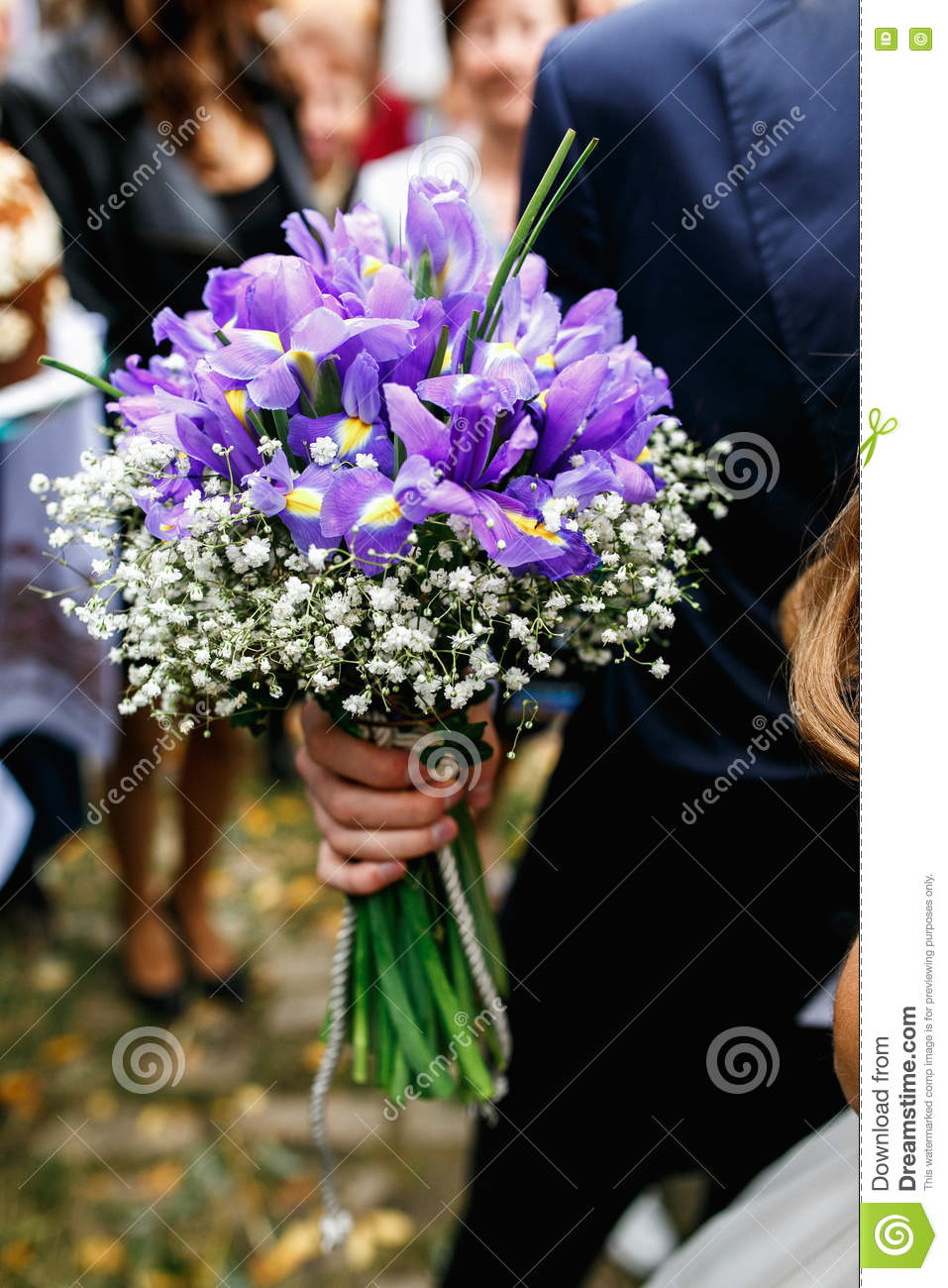 Man holds a wedding bouquet of violet crocuses stock image image royalty free stock photo izmirmasajfo Image collections