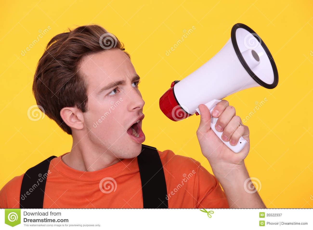 Man Hollering Into Megaphone Royalty Free Stock