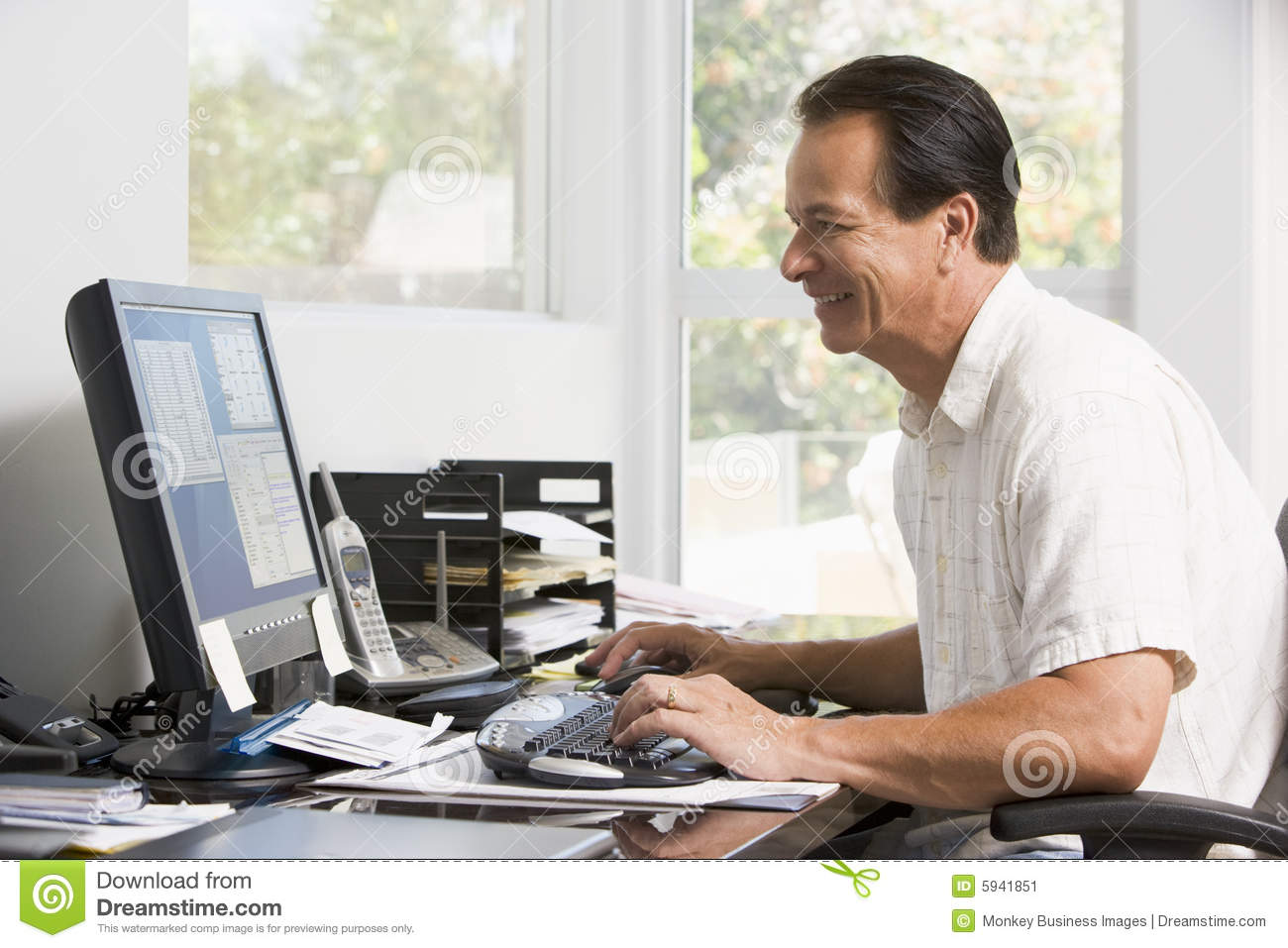 Man In Home Office At Computer Smiling Stock Image - Image of seated ...