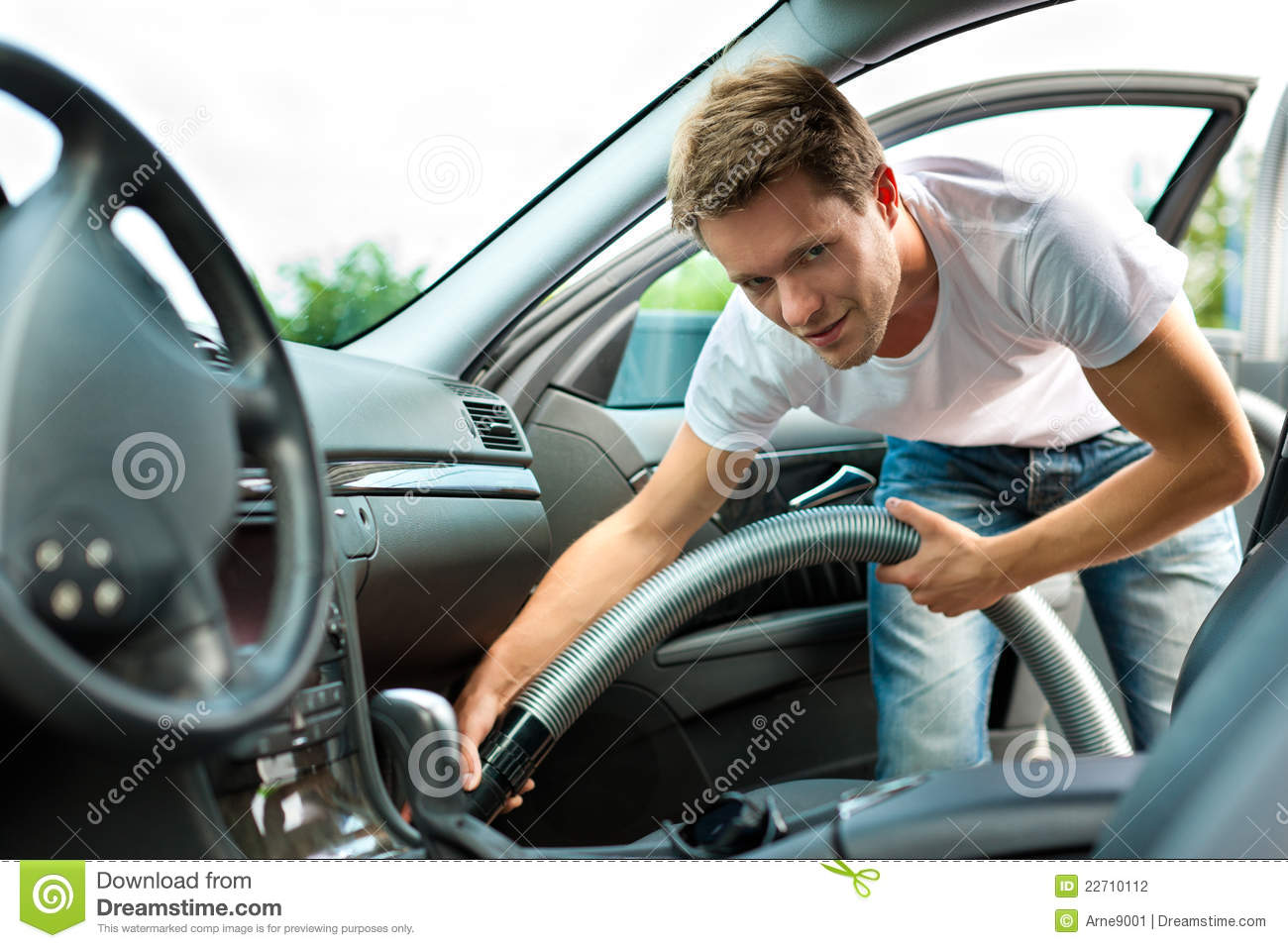 Man is hoovering or cleaning the car stock photo image for Clean car pictures