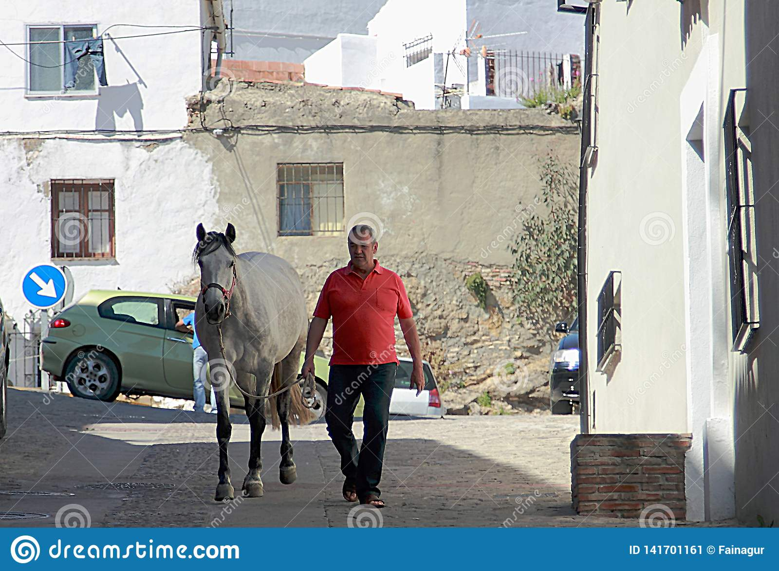 Man and horse on the street of Ronda