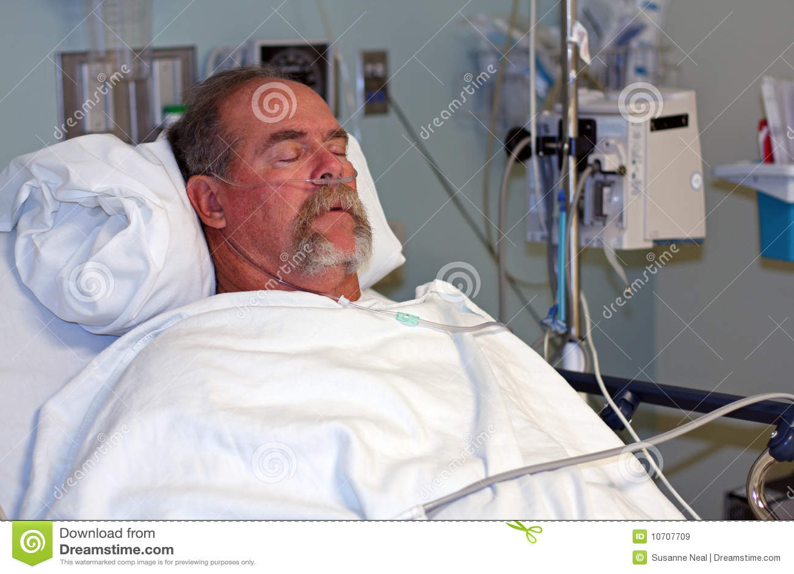 Man in hospital bed asleep