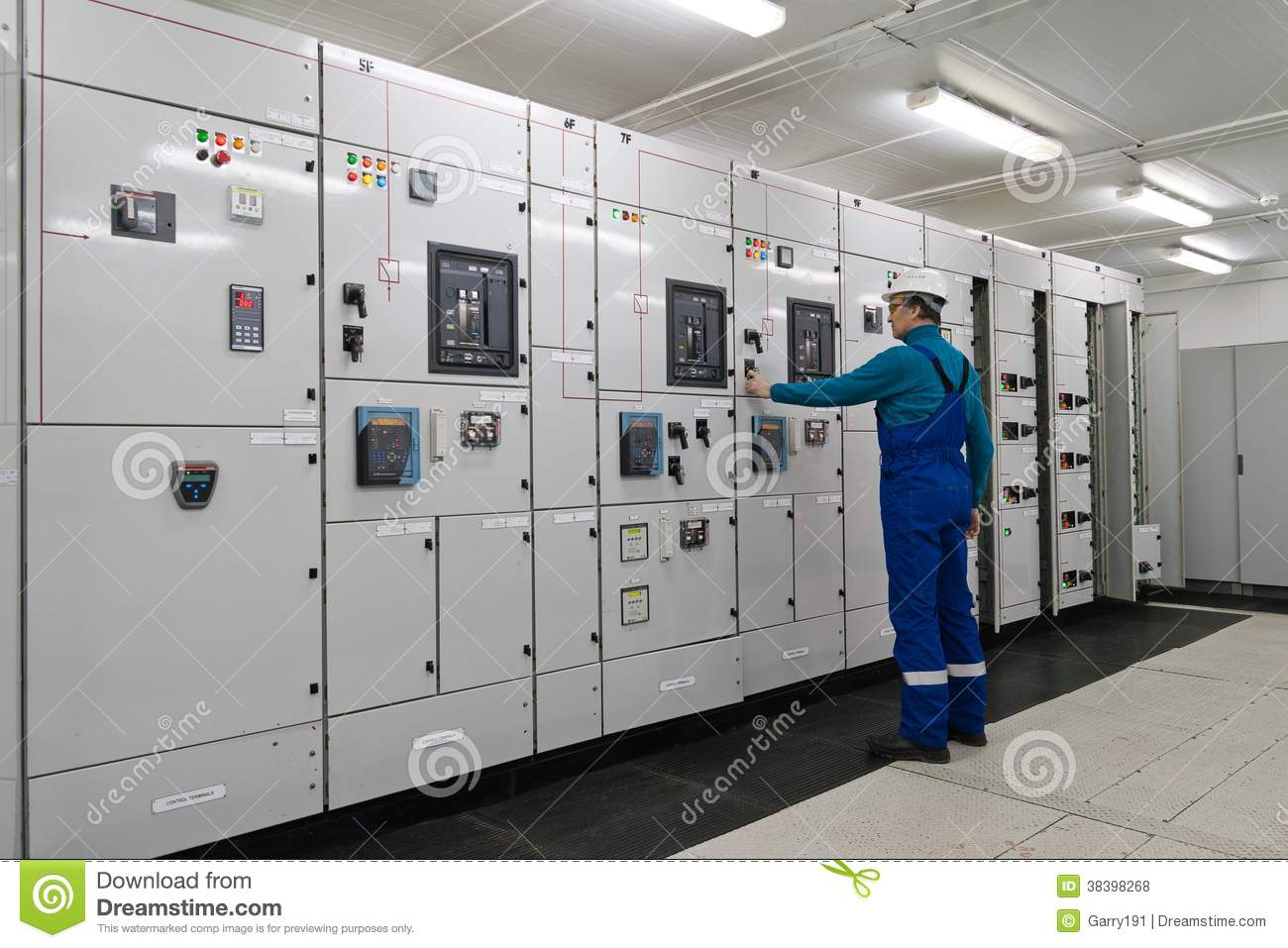 Man is inside electrical energy distribution substation for Distribution substation