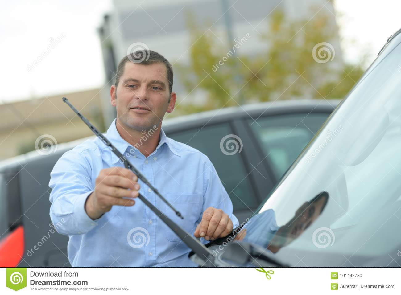 man inspecting cars wipers stock photo image of reflection 101442730. Black Bedroom Furniture Sets. Home Design Ideas