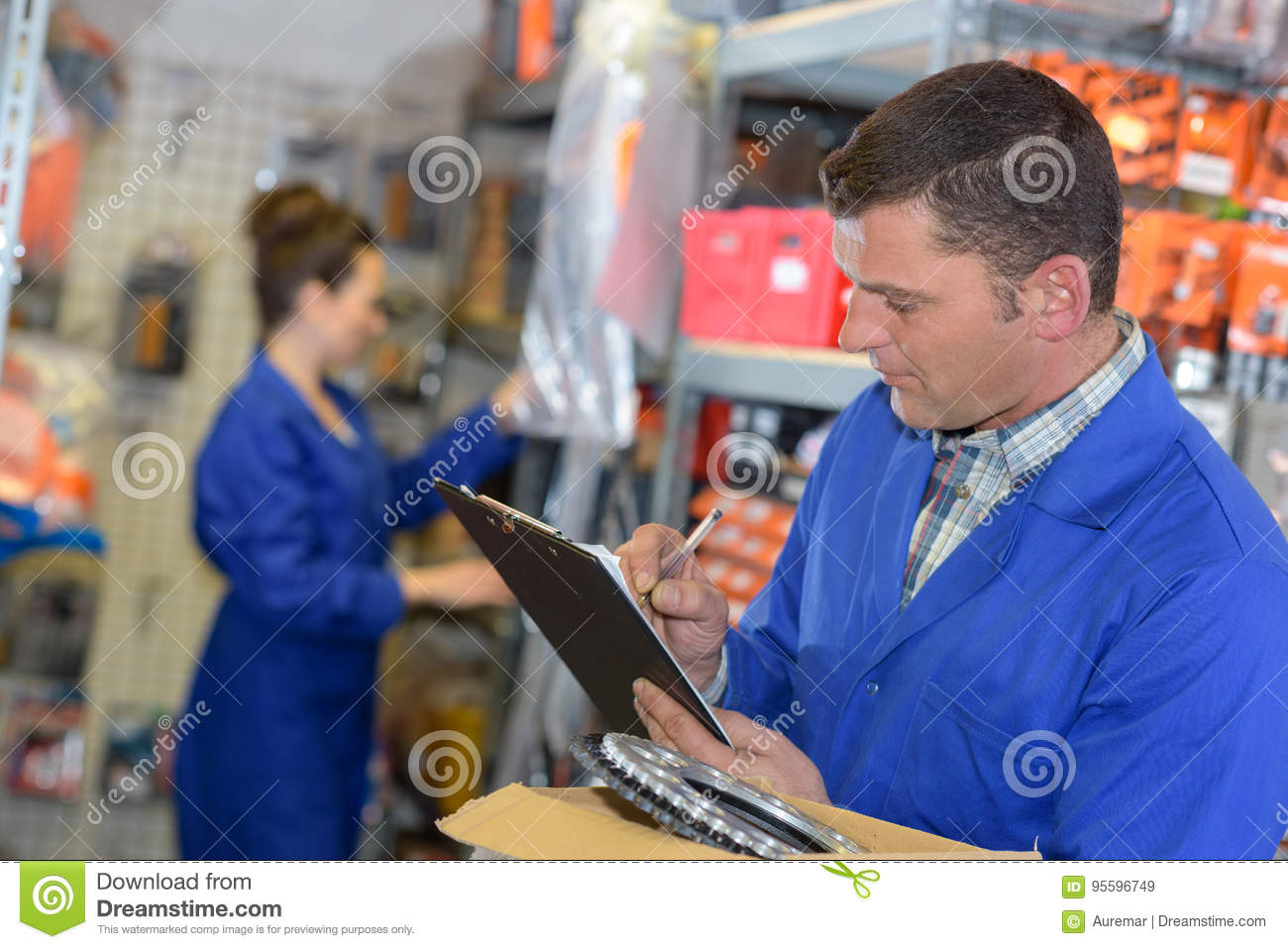 Man inspector doing inventory in warehouse