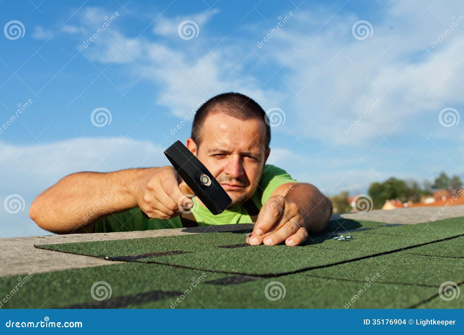 man installing bitumen roof shingles stock images image 35176904. Black Bedroom Furniture Sets. Home Design Ideas