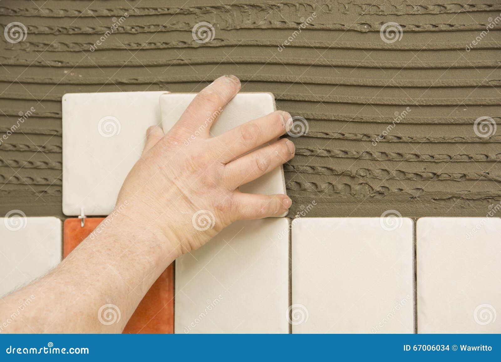 Download Man Installing Ceramic Tile Stock Photo - Image of repair, adhesive: 67006034