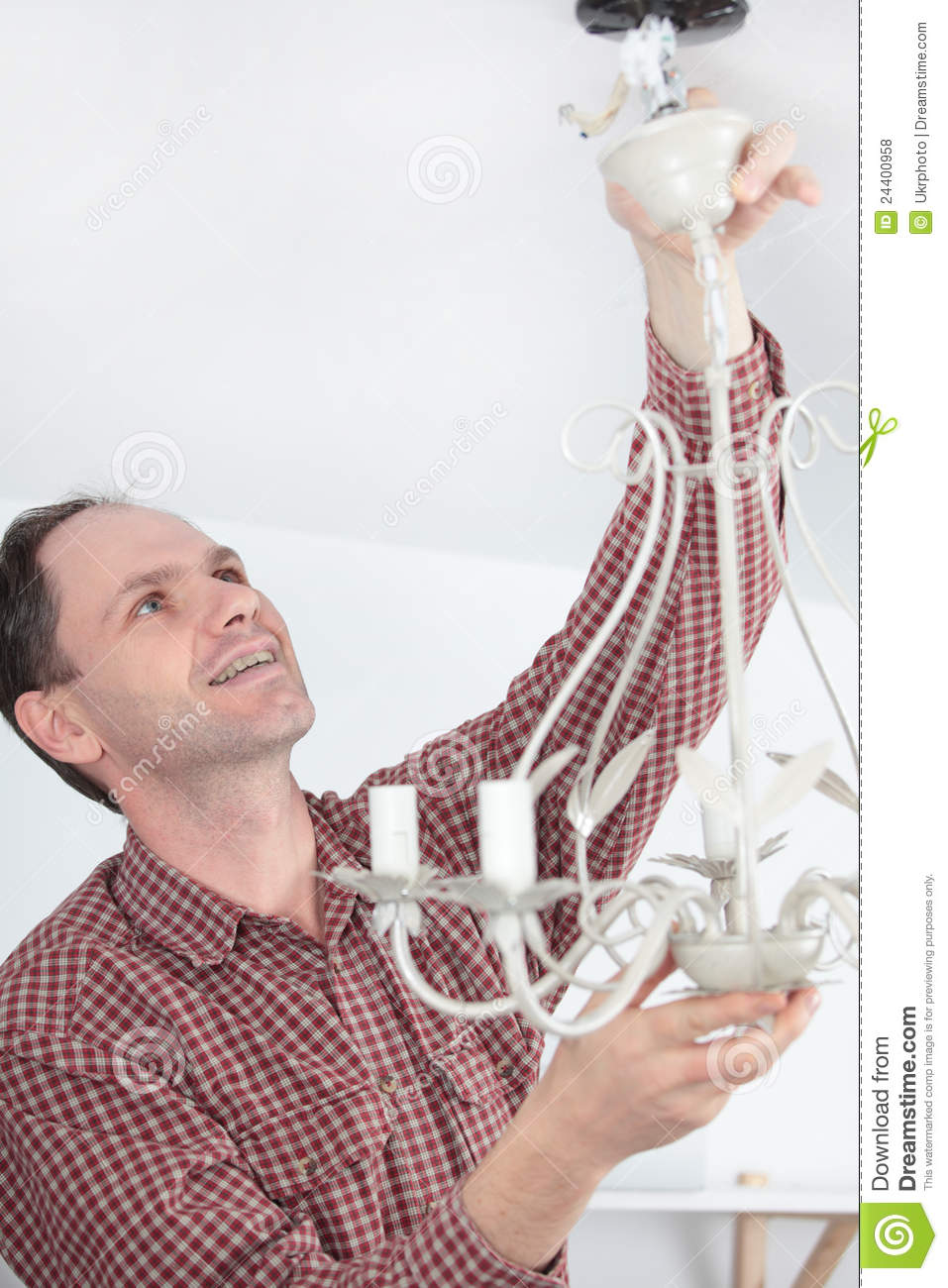 Man Installing Chandelier Royalty Free Photos Image 24400958 – Installing a Chandelier