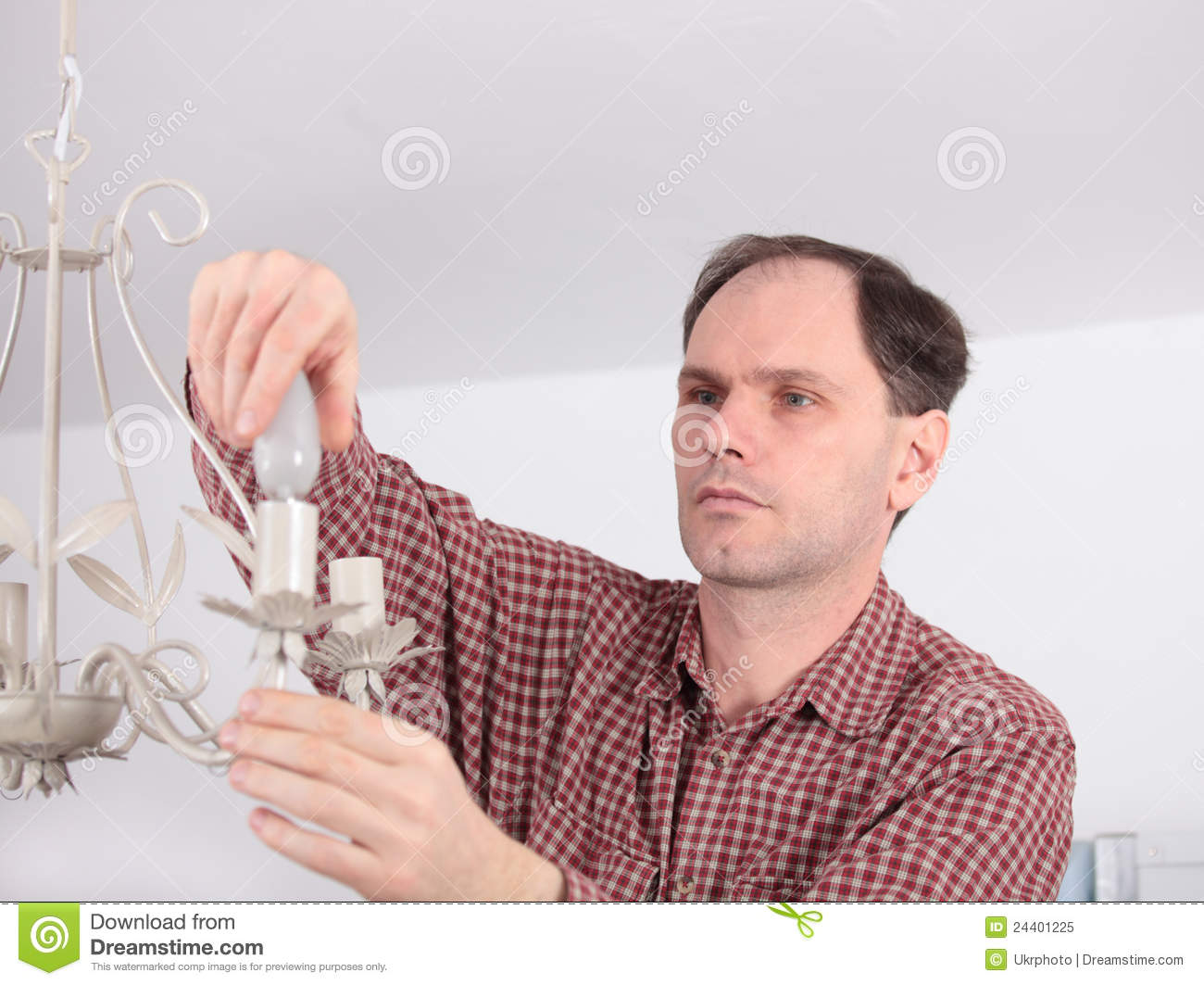 Man Installing Chandelier Royalty Free Photo Image 24401225 – Installing a Chandelier