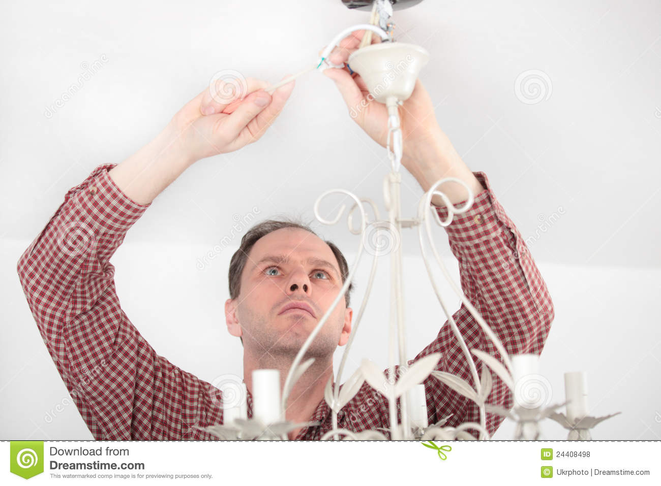 Man Installing Chandelier Royalty Free Photos Image 24408498 – Installing a Chandelier