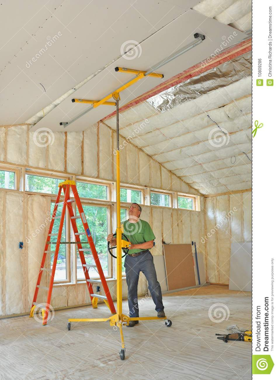 How to hang drywall on walls - Man Installing Drywall On Ceiling