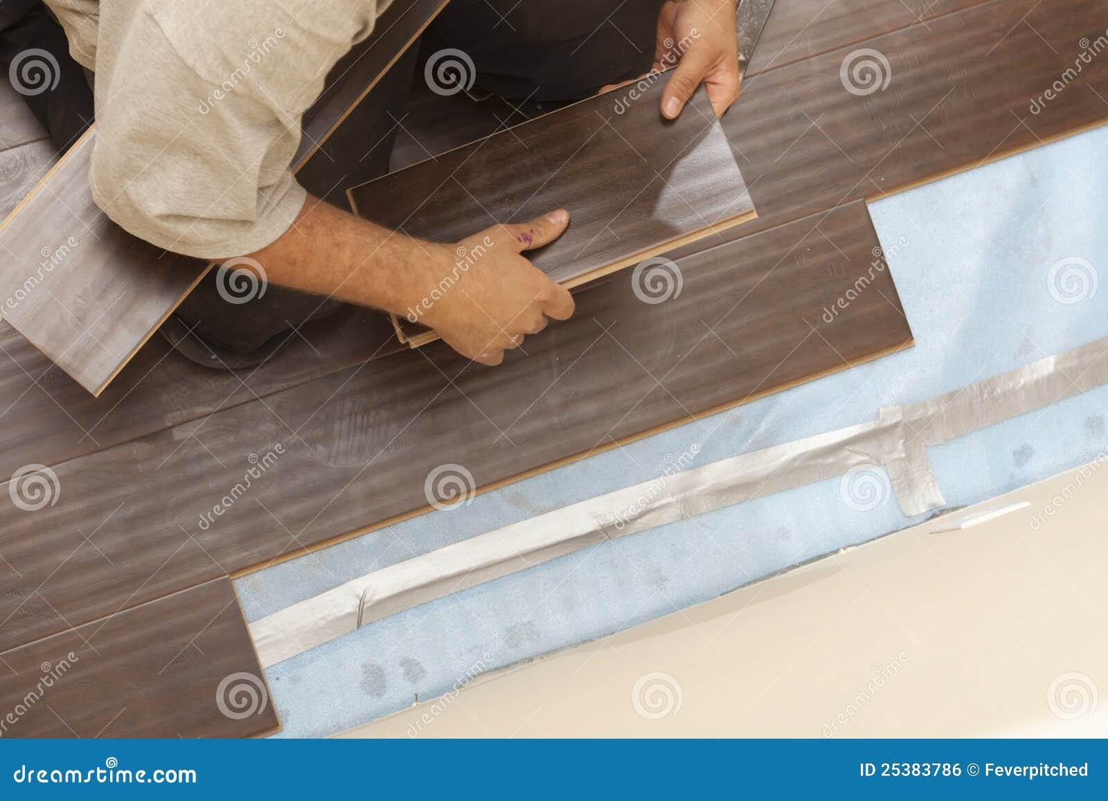 Man Installing New Laminate Wood Flooring