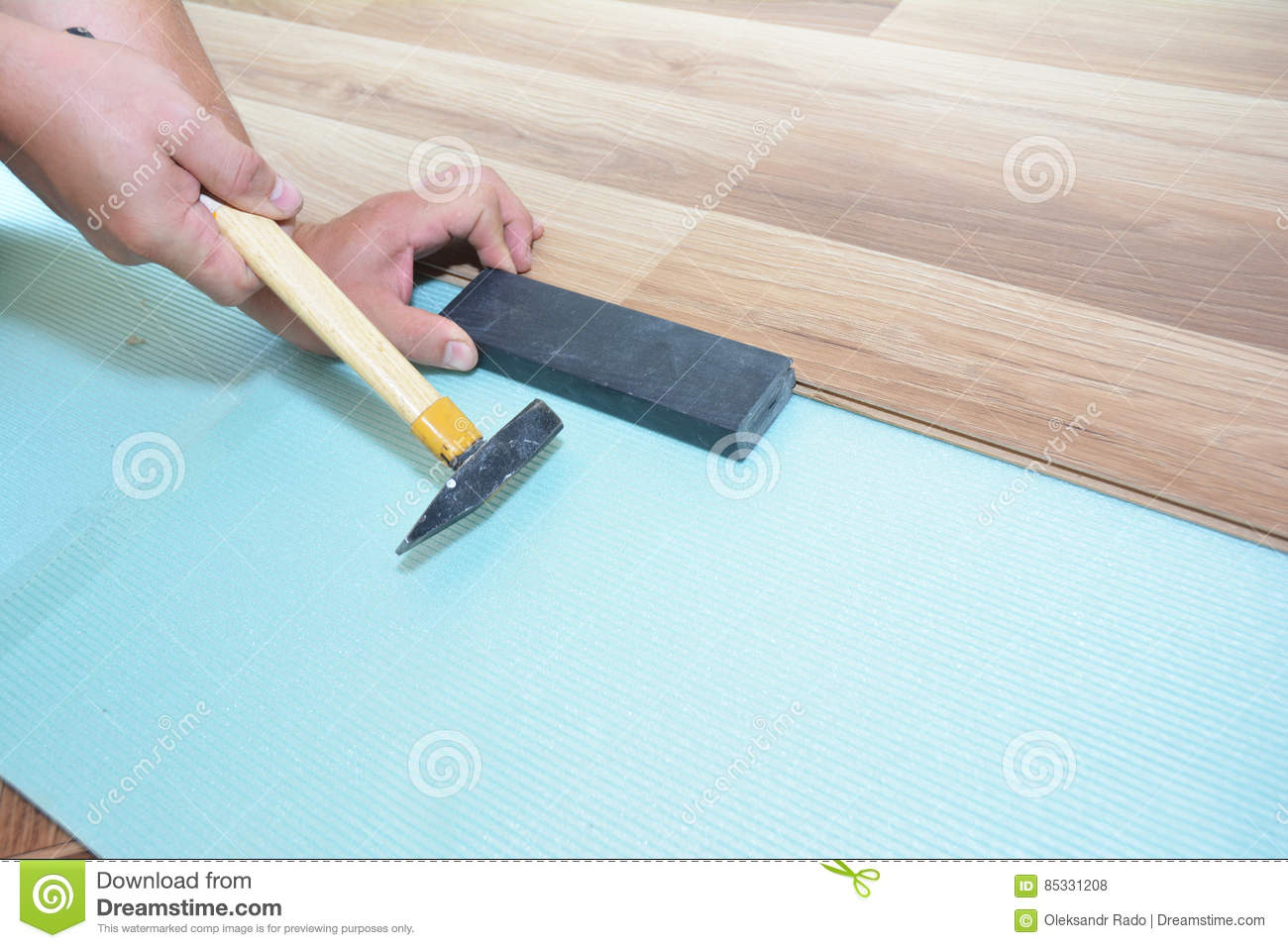 Man Installing New Laminate Wood Flooring Worker Installing Wooden