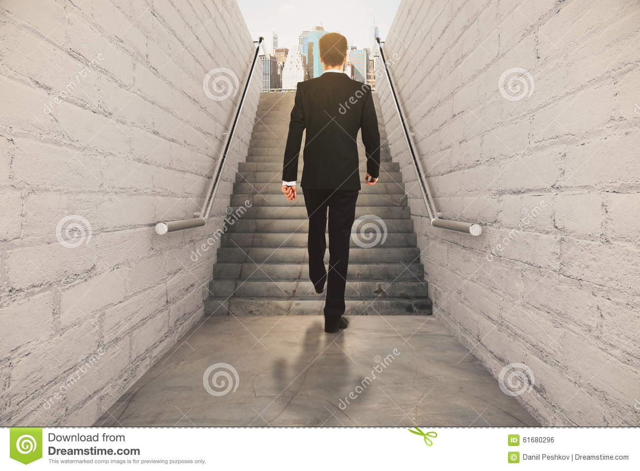Man isclimbing up the stairs between brick walls and con for Concrete floor upstairs