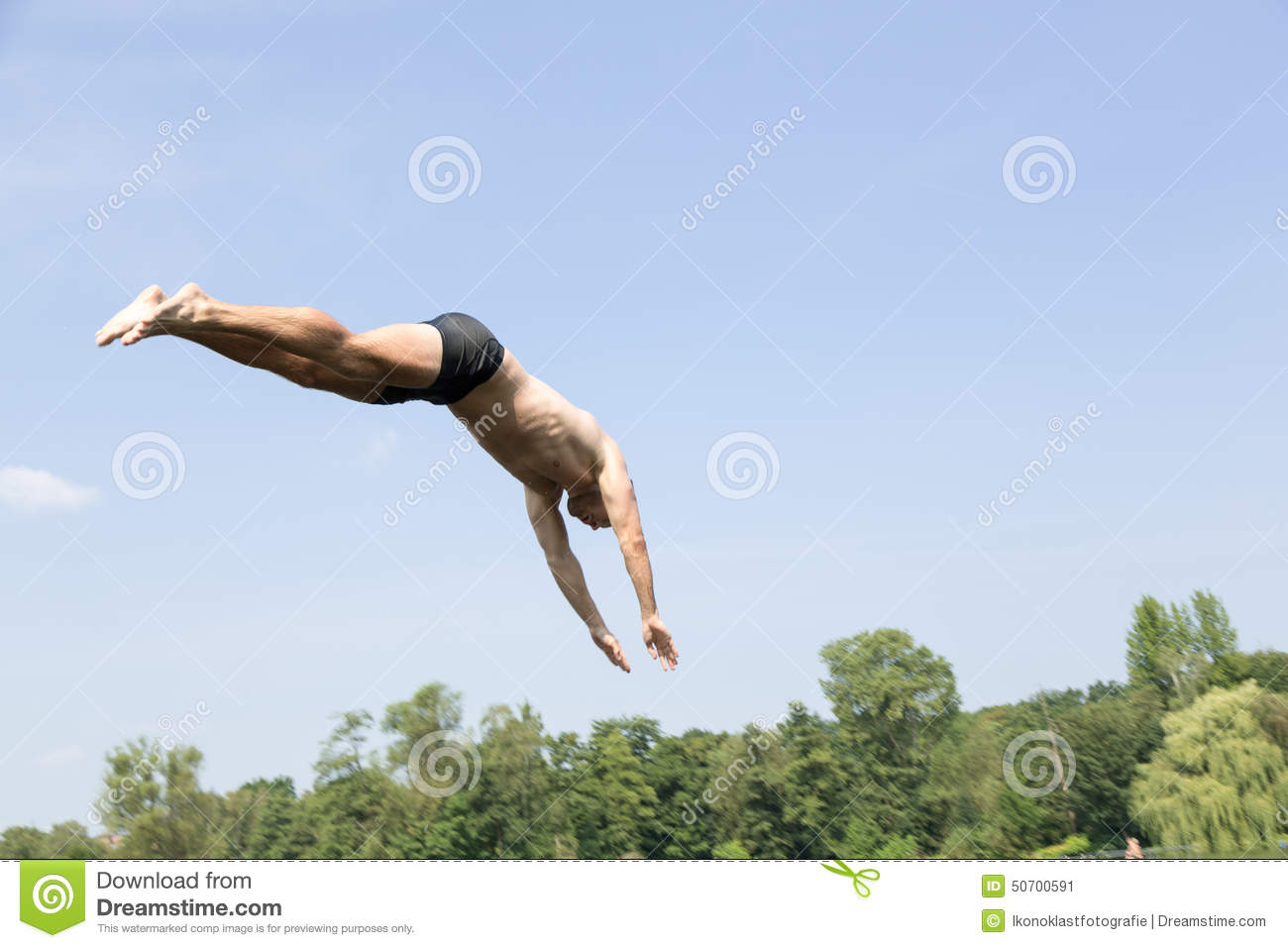 Public Swimming Pools With Diving Boards man jumping off diving board at swimming pool stock photo - image