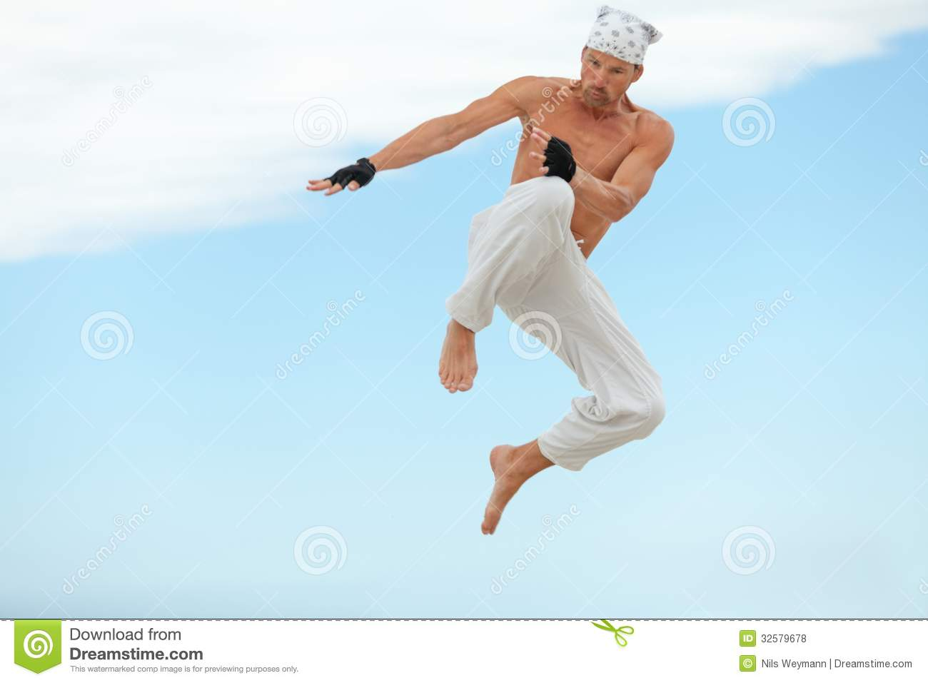 man is jumping sport karate martial arts fight kick stock photo
