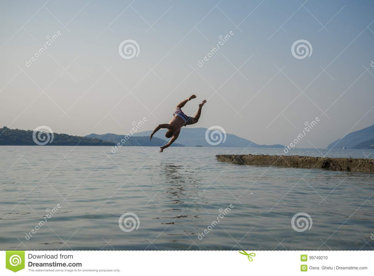 A man jumping into the water