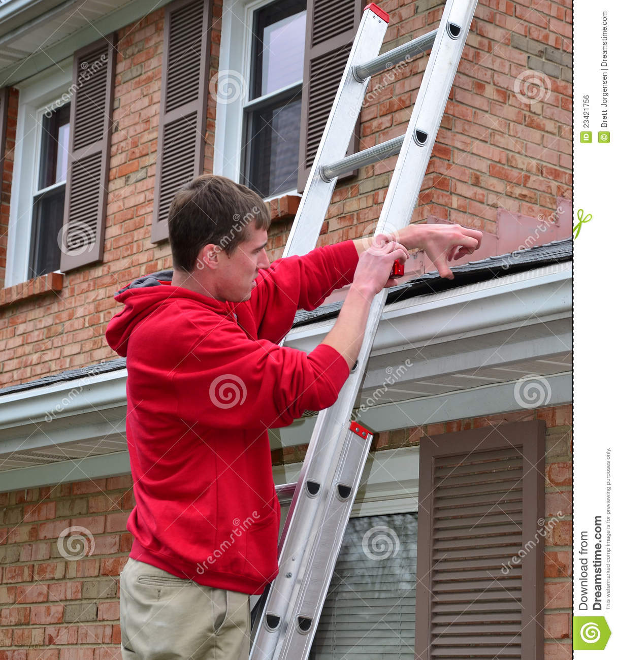 Man On Ladder On A Roof Stock Photo Image Of Character