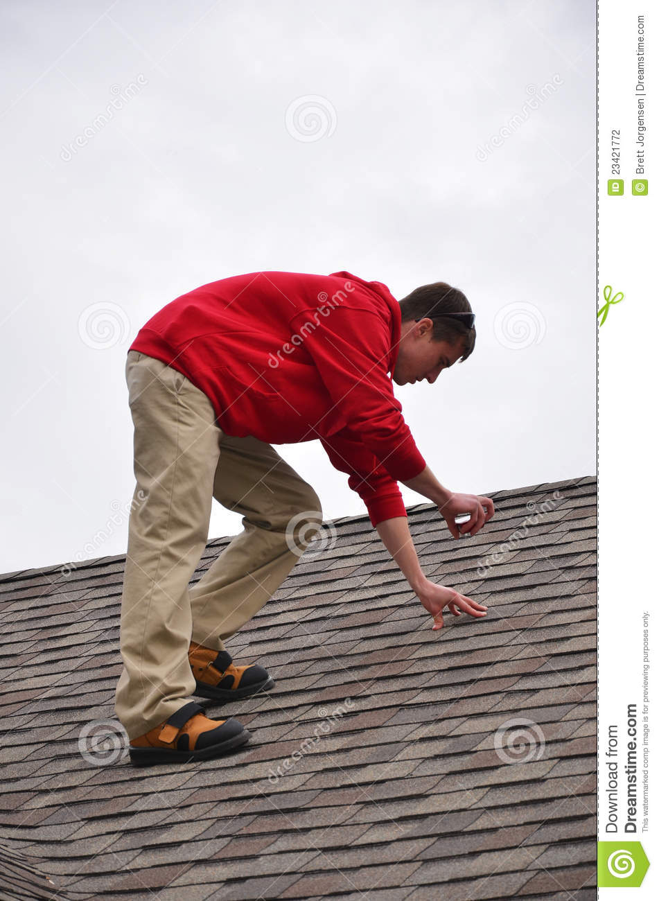Man On Ladder On A Roof Stock Photo Image Of Dangerous
