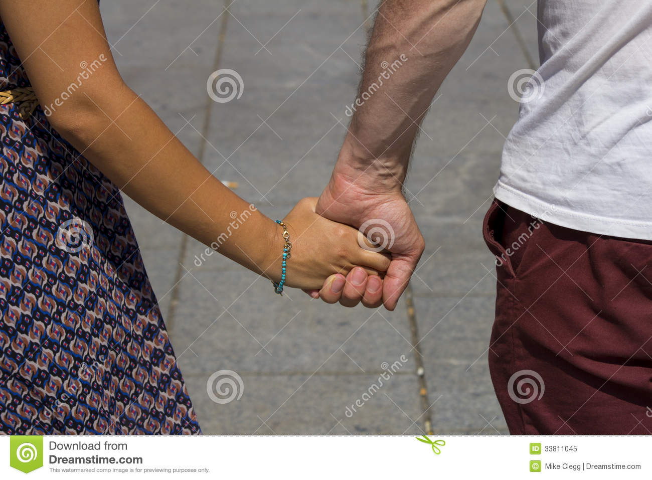 What holding hands means to a guy