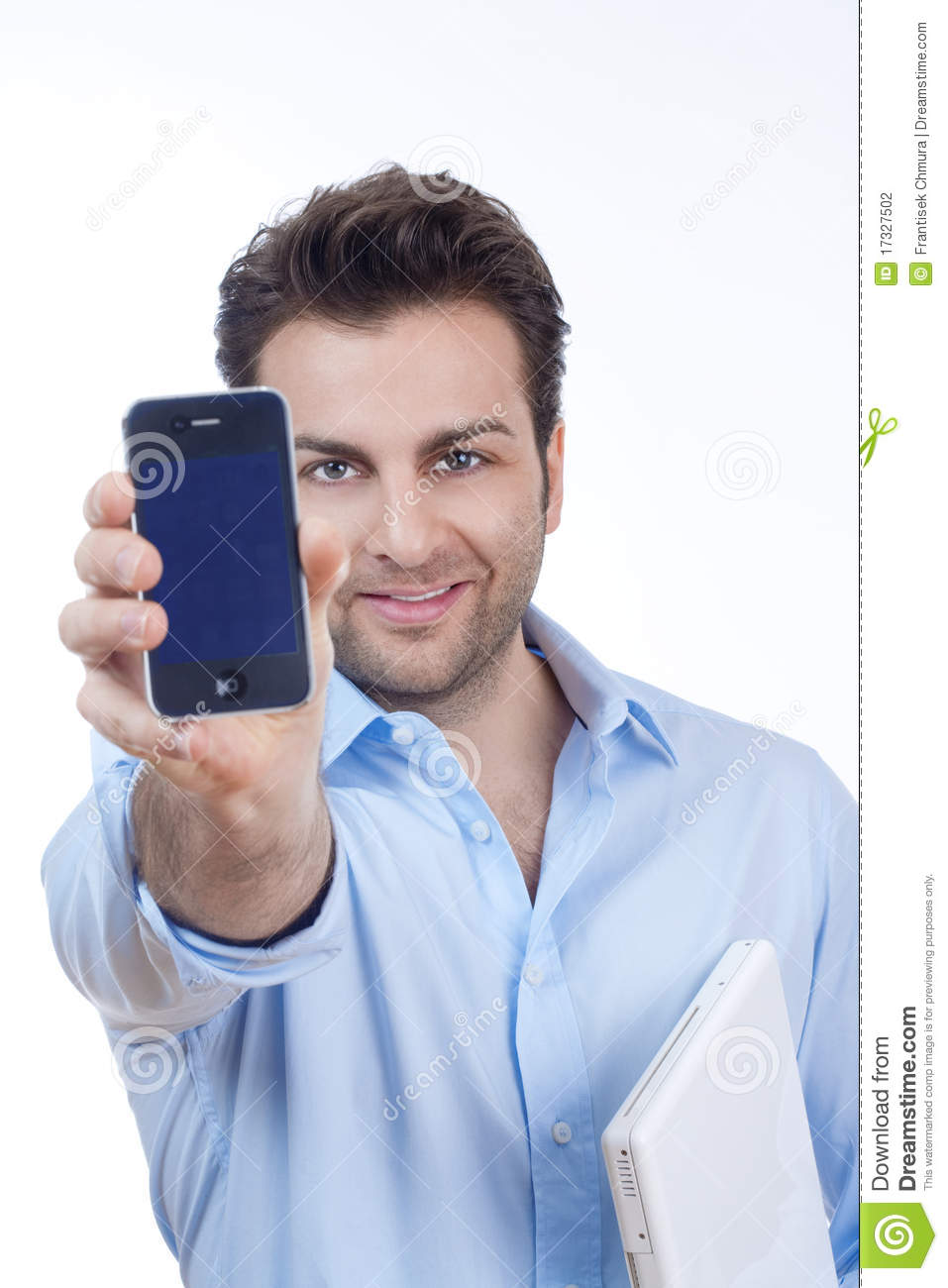 Man On Cell Phone : Man with laptop and cell phone stock photography image