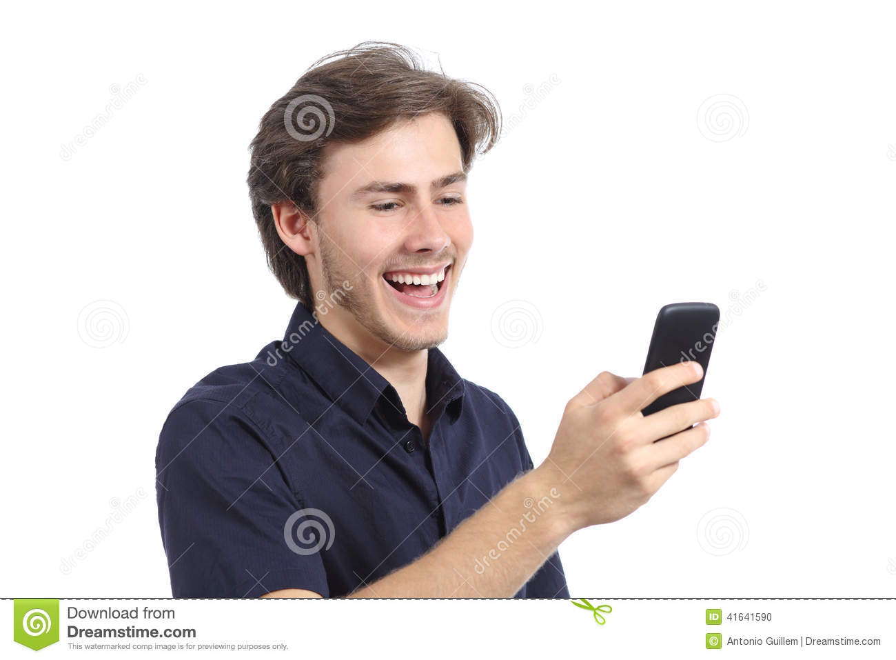 Man On Cell Phone : Man laughing texting on the mobile phone stock photo