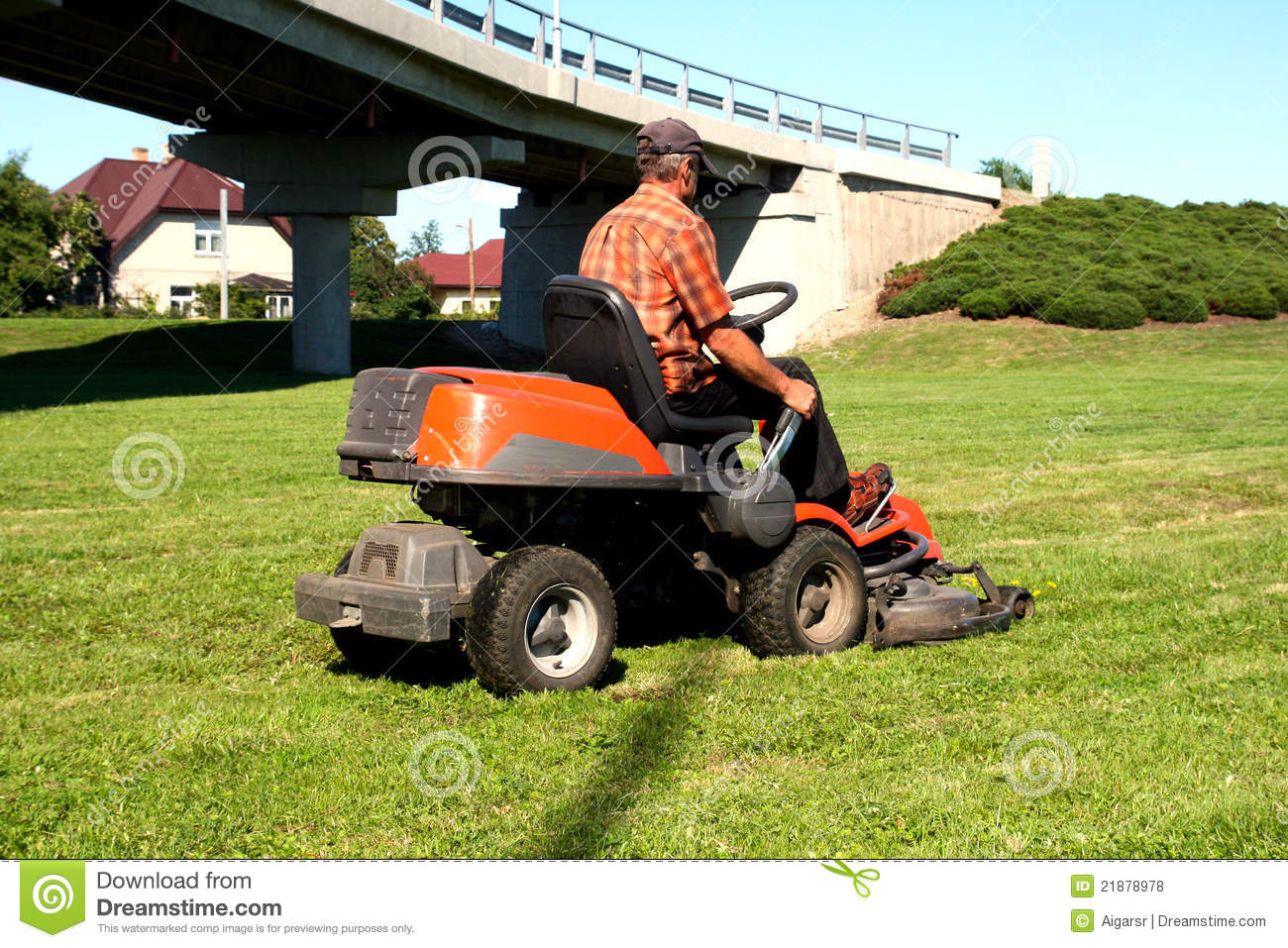 Man On Tractor Lawn Enforcment : Man on a lawn tractor stock photo image of