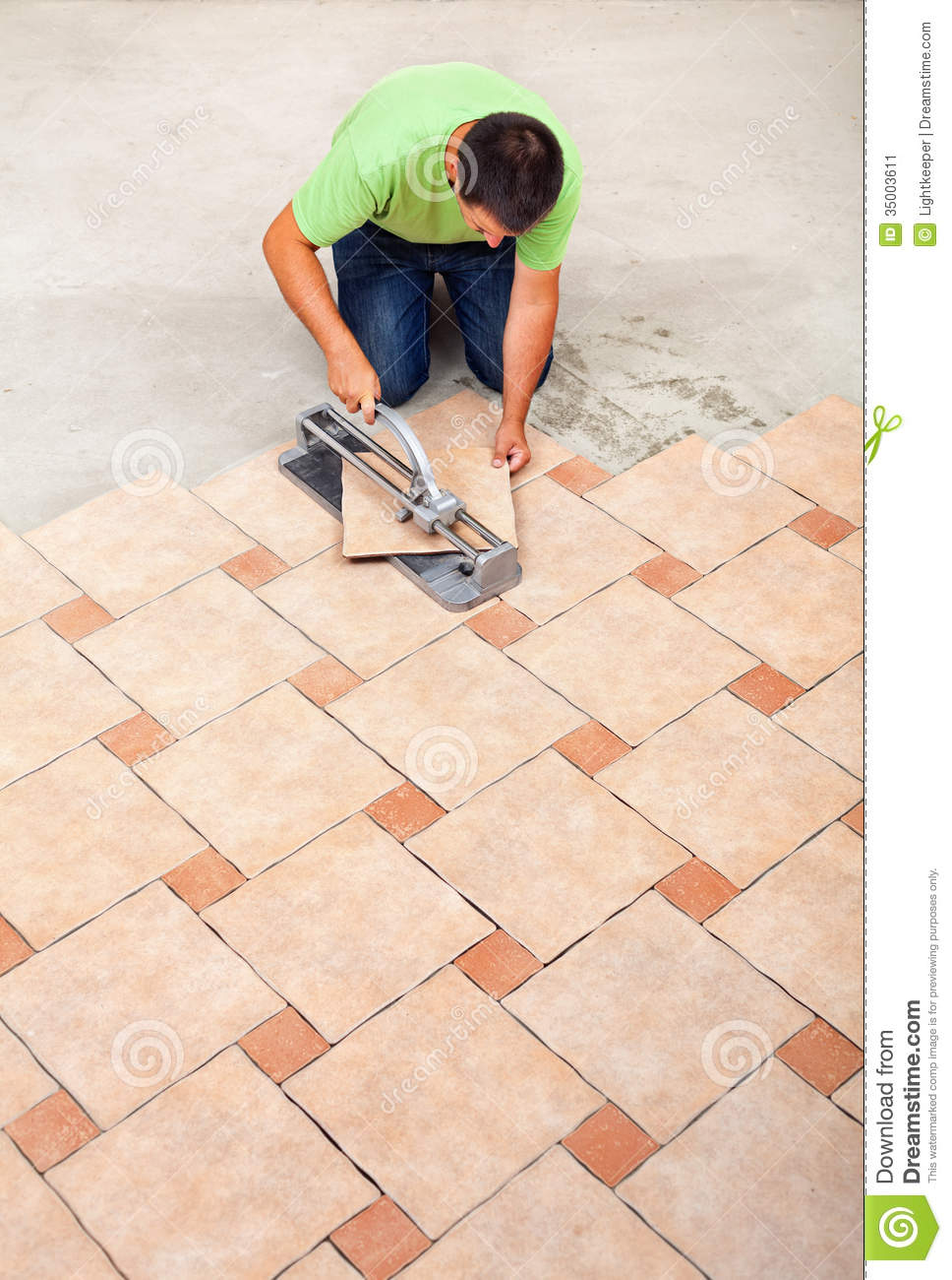 Man Laying Ceramic Floor Tiles Stock Image - Image of tool, flooring ...