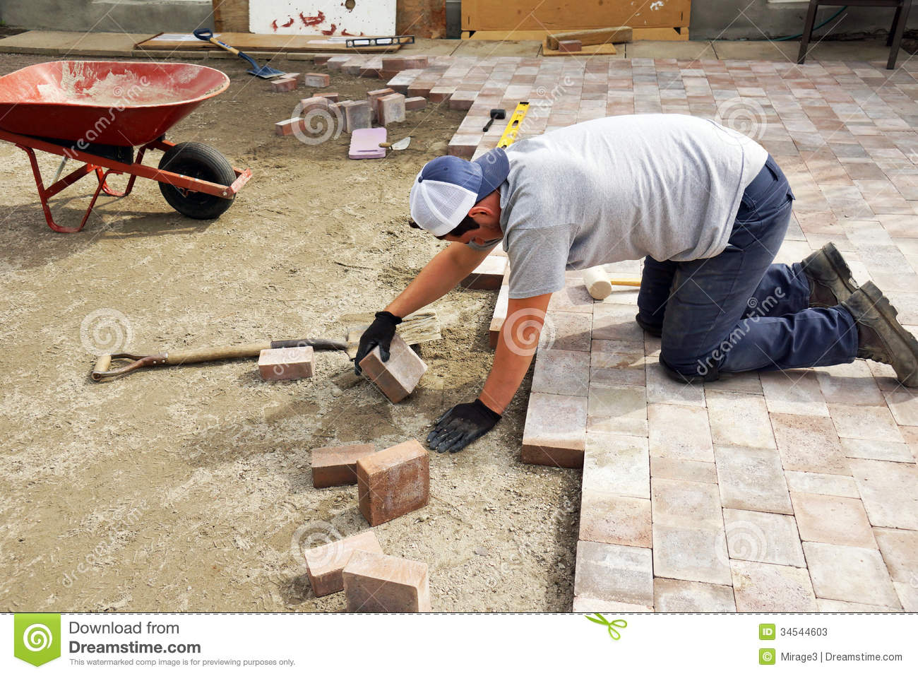 Man Laying Down Paver Stock Photos Image 34544603