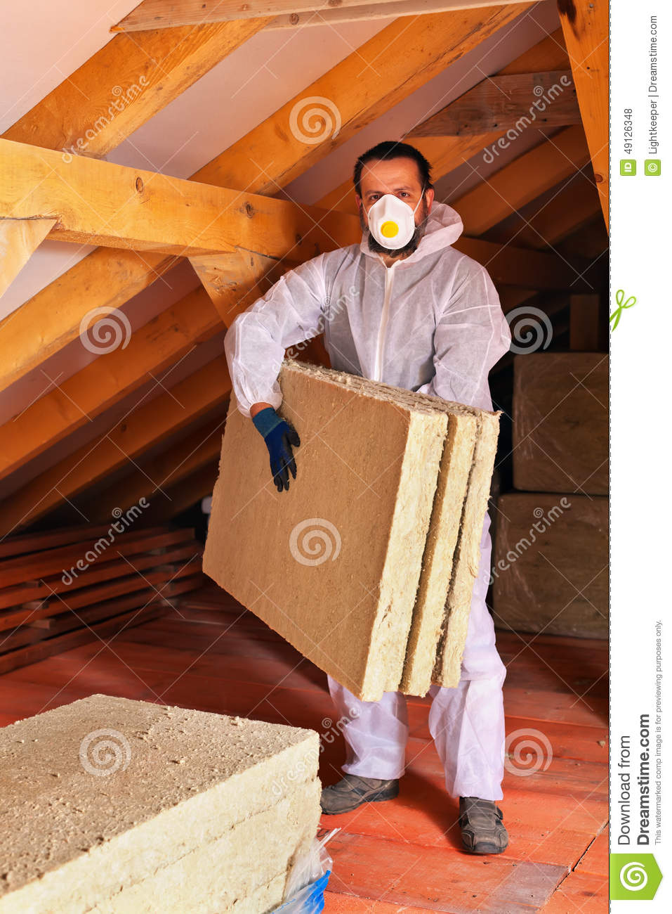 Man Laying Thermal Insulation Layer Under The Roof Stock ...