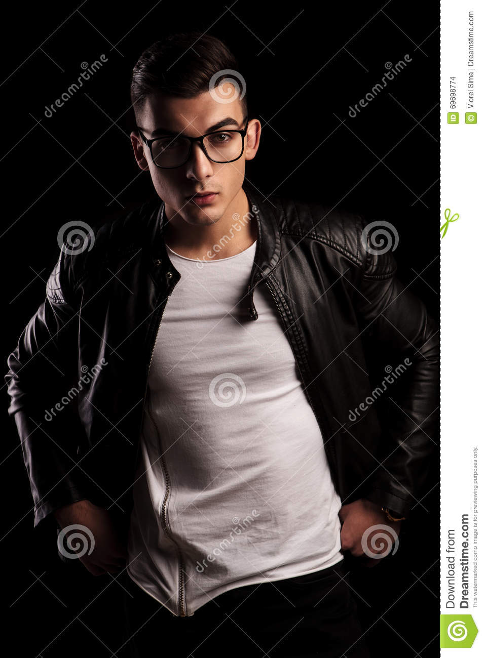 2adcc1418d5 Man In Leather Jacket Wearing Glasses With Hands On Waist Stock ...