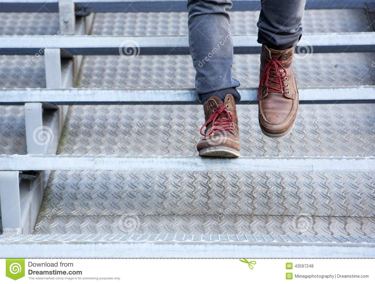 Man In Leather Shoes Walking Downstairs Stock Photo