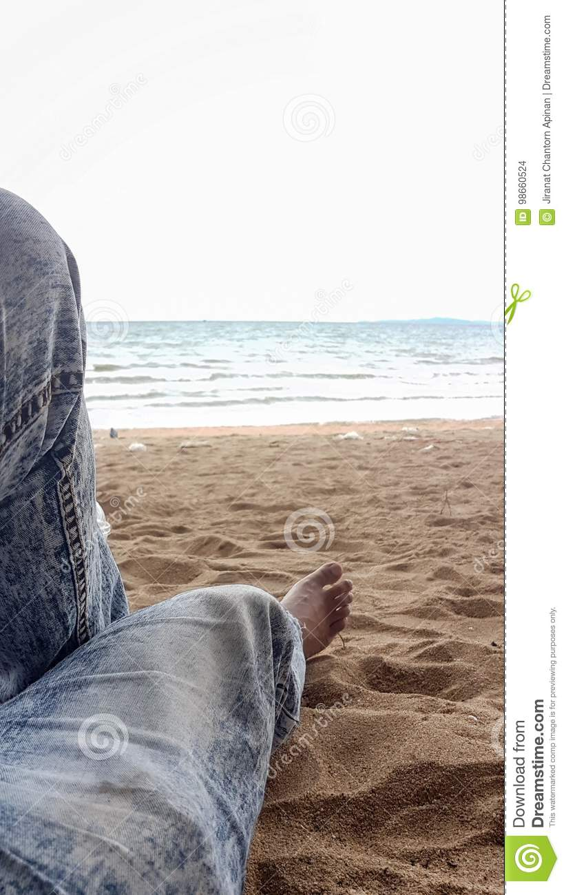 100% high quality factory authentic fashion style Man Leg Wear Long Jeans Relax On The Sand Beach In His ...