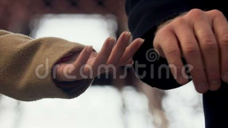 Man Letting Go Woman Hand And Leaving Couple Breaking Up Outdoor