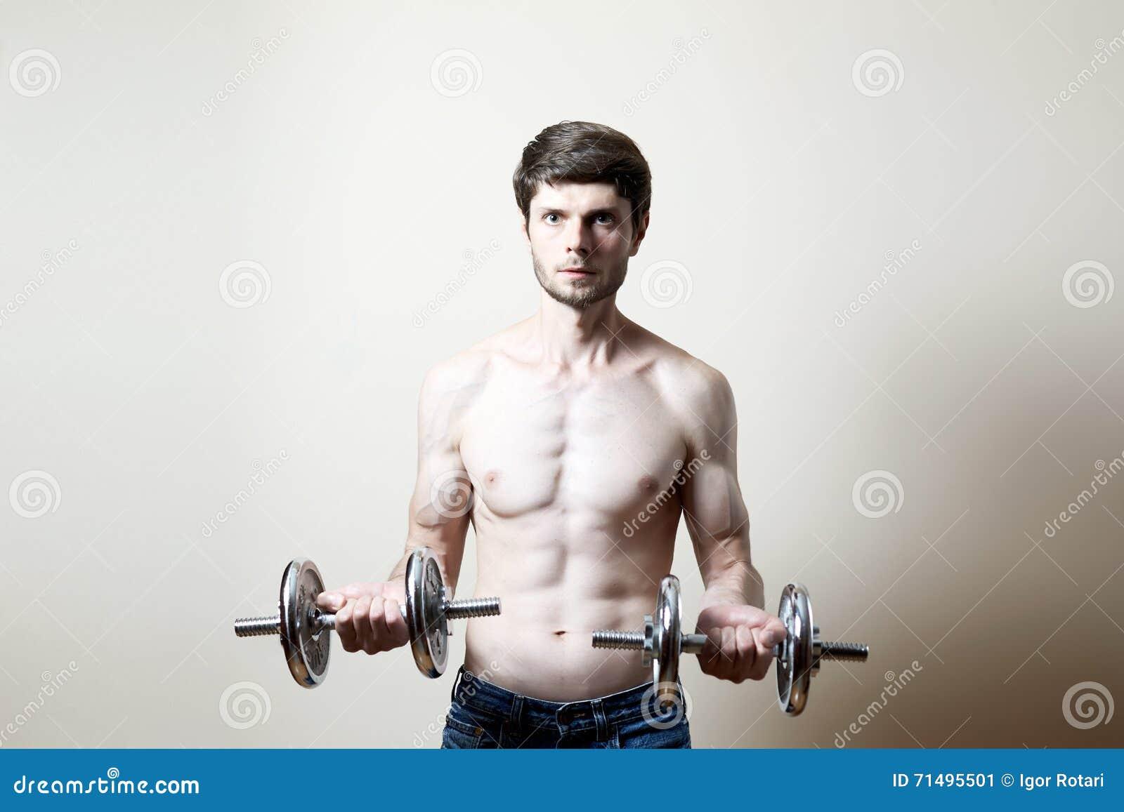 Man lifting dumbbell stock image  Image of ectomorph - 71495501