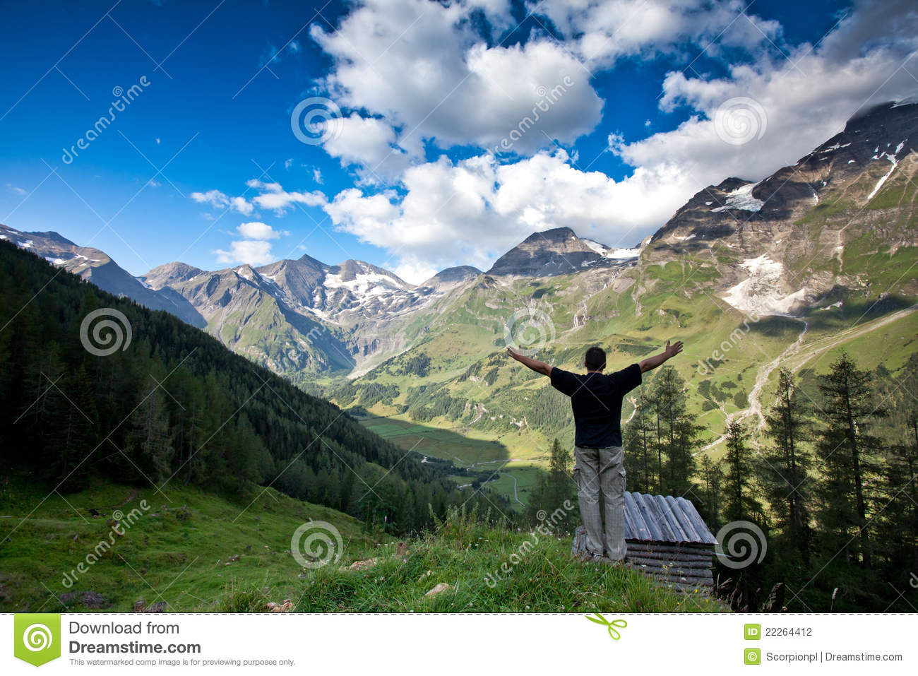 Man lifts her arms in victory