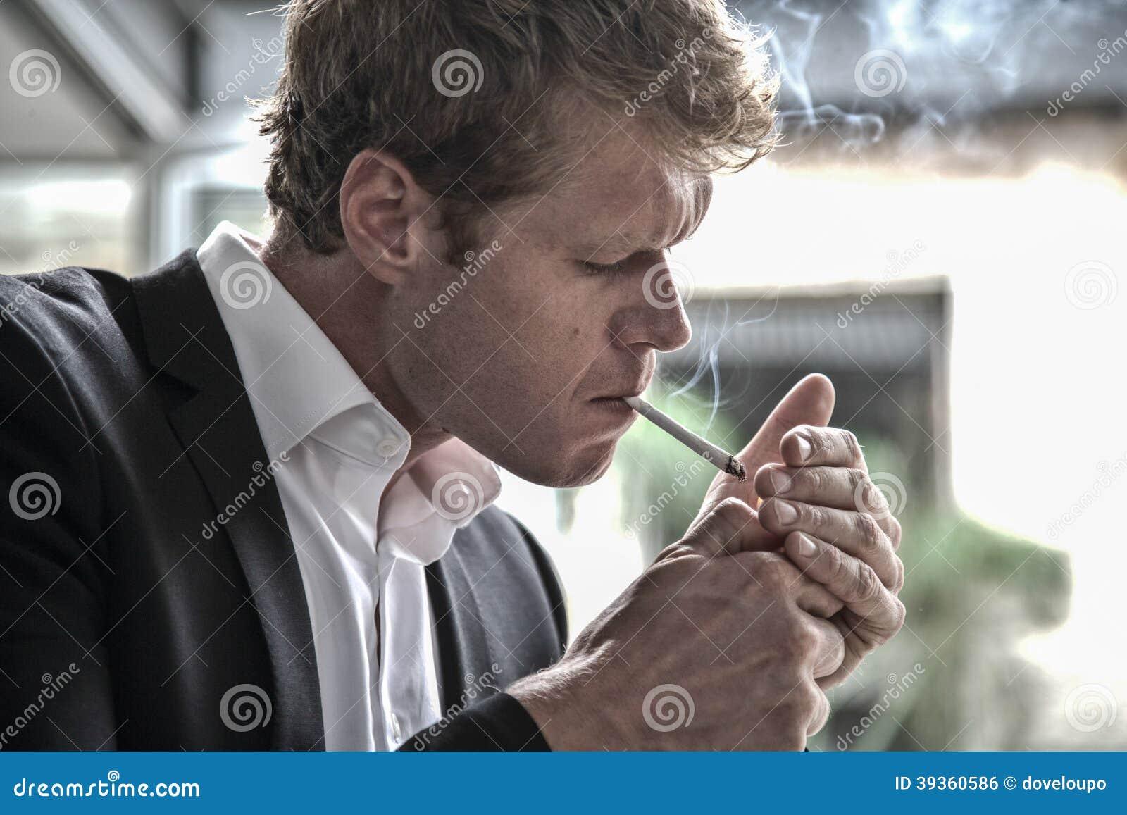 Man lighting a cigarette  sc 1 st  Dreamstime.com & Man lighting a cigarette stock photo. Image of details - 39360586 azcodes.com