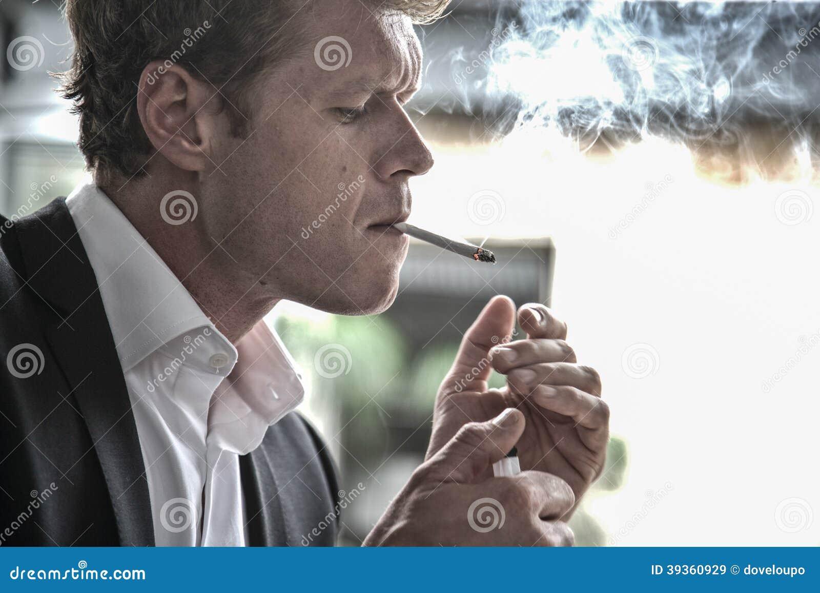 Man lighting cigarette  sc 1 st  Dreamstime.com & Man lighting cigarette stock image. Image of smoke formal - 39360929 azcodes.com