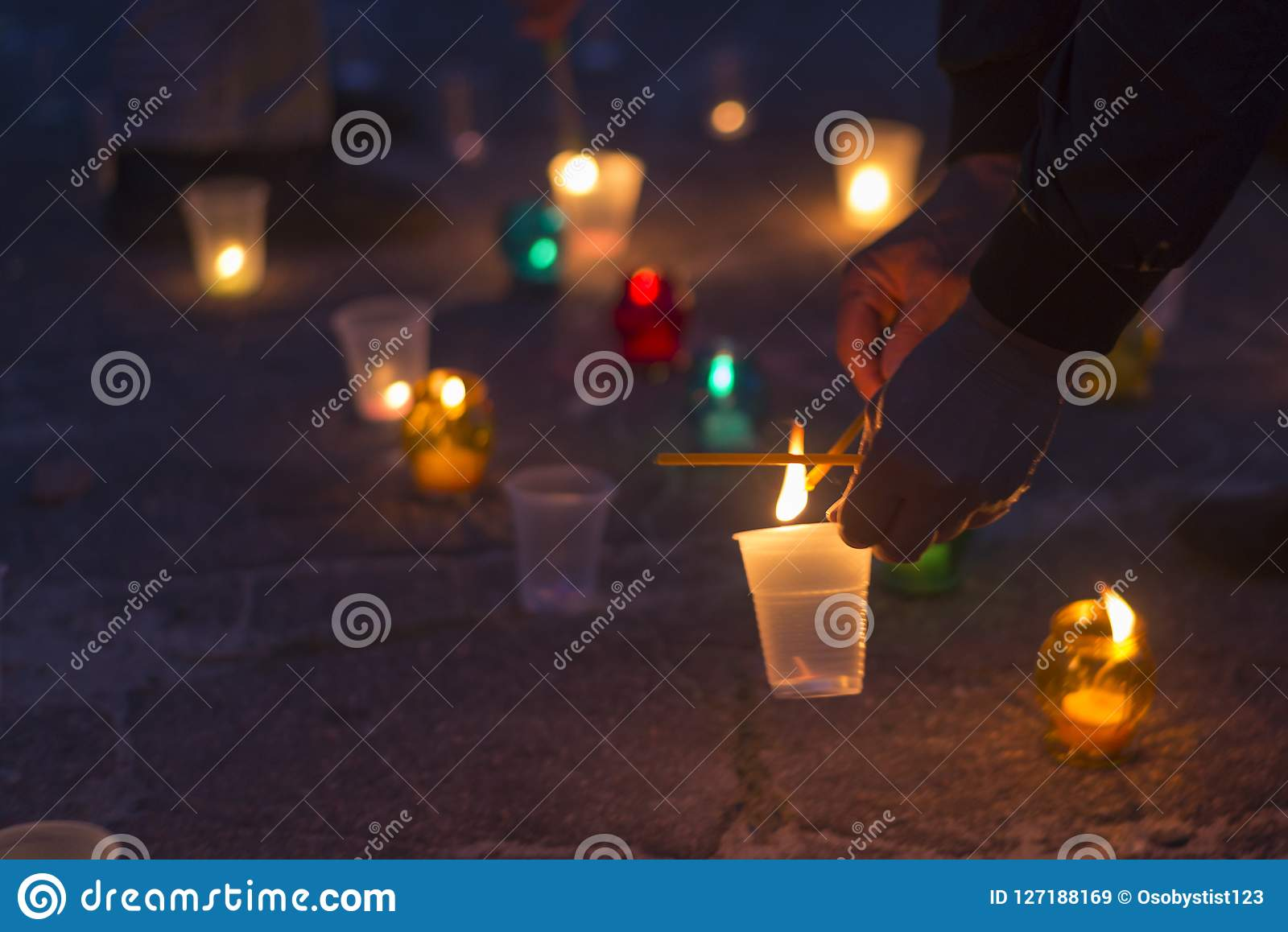 A man lights a candle. Day of Remembrance for the Bereaved