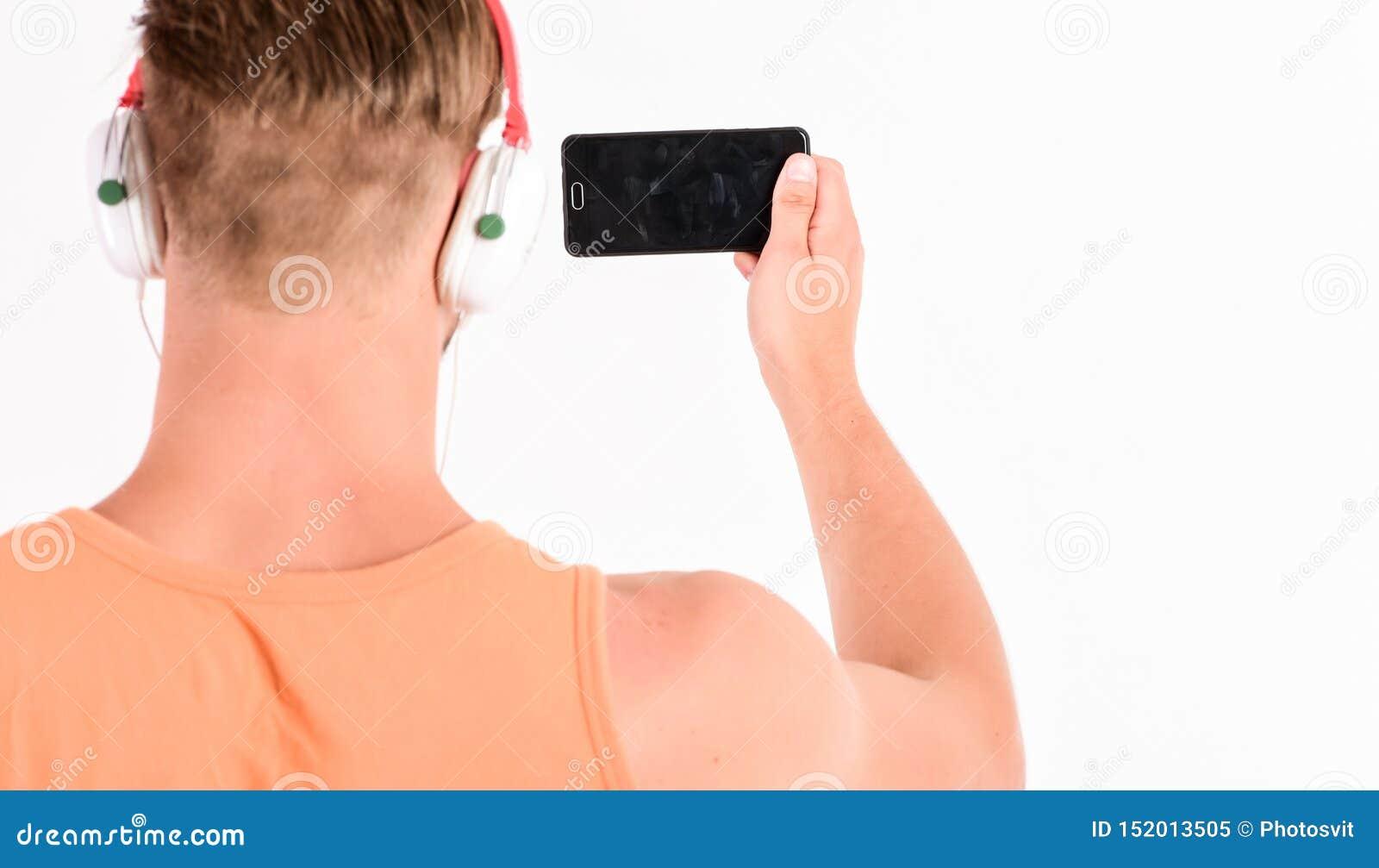 Man listen music headphones and smartphone white background. Modern technology. Music application concept. Enjoy perfect