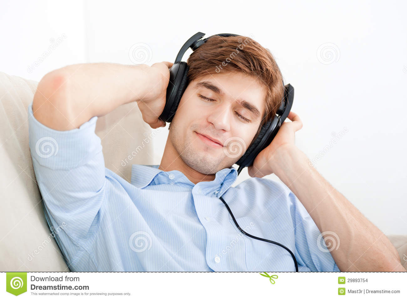 man-listening-music-headphone-sofa-home-
